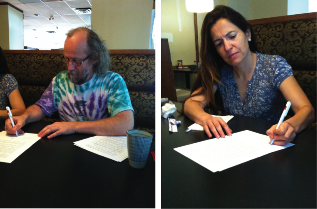 The historic moment: Marc Schoenauer and Anna Esparcia-Alcazar, signing the legal documents